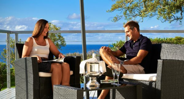 Couple On Verandah Close Up Norfolk Island Accommodation
